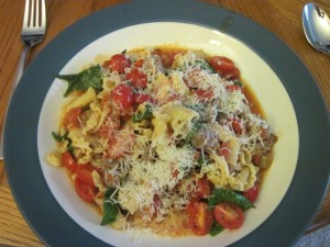 Campanelle with sausage, tomatoes and spinach